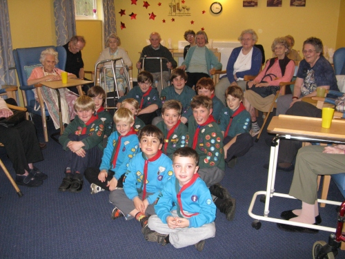 Beavers, Cubs and Scouts from 10th Romsey join residents of Nightingale Lodge for a New Years Singalong